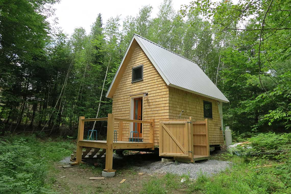 Tiny timber frame house emerald builders for Builders to build a house